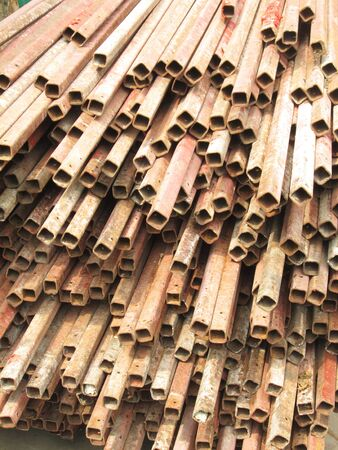 Rusty rebar steel used in construction background texture photo