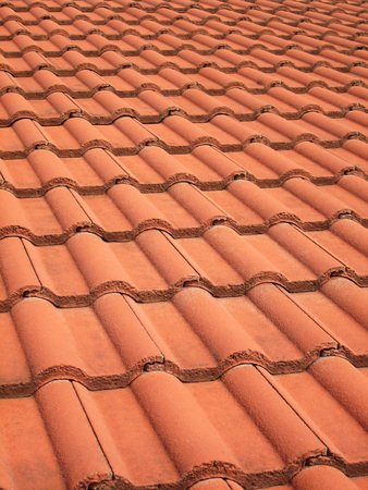 red clay: Closeup of the red clay roof tiles