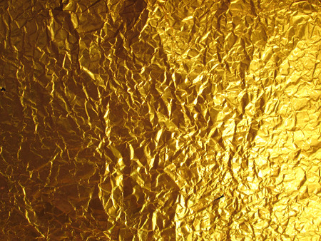 shiny gold: Shiny yellow gold foil abstract texture background Stock Photo