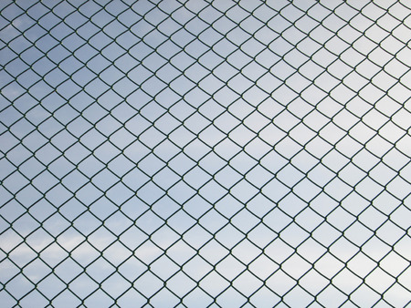 chain fence: Green seamless fence chain, Iron wire fence on blue sky background