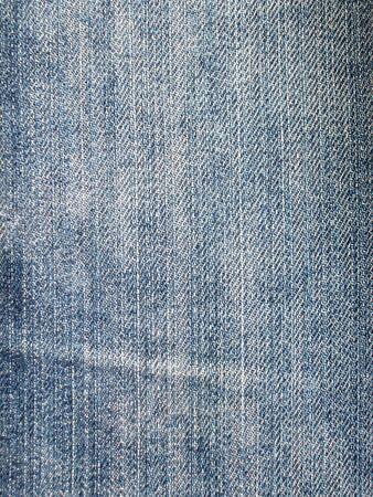 Blue jeans texture close-up background