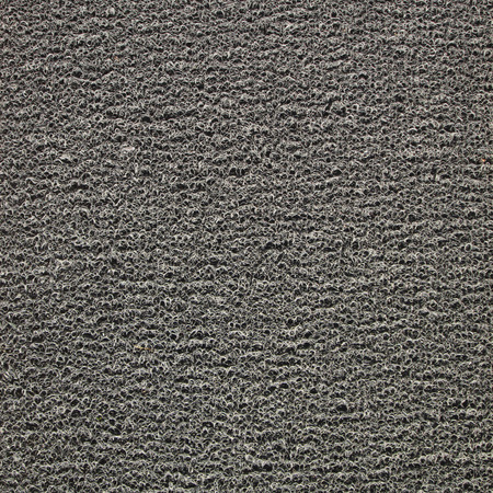 turmoil: Background of black carpet or foot scraper or door mat texture Stock Photo