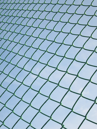chained link fence: Green seamless fence chain, Iron wire fence on blue sky background