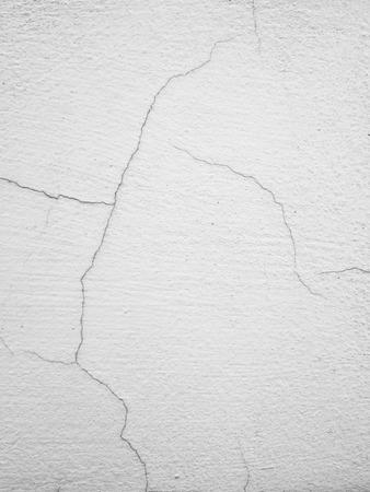 long way: Cracked concrete wall a long way