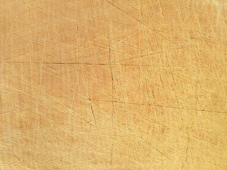 wooden texture: Old and used natural wooden cooking board with cuts