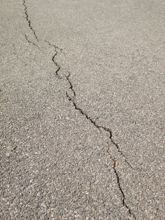 dint: cracked asphalt background Stock Photo