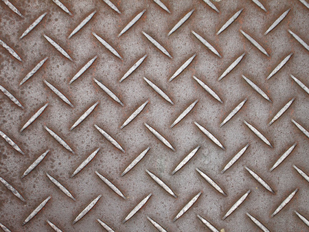 diamondplate: Background of metal diamond plate in brown silver color