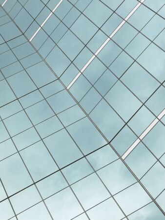 glass reflection: highrise glass building with sky and clouds reflection Stock Photo