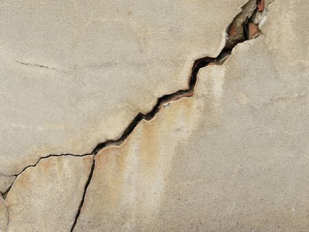 cracked wall: crack on cement wall Stock Photo