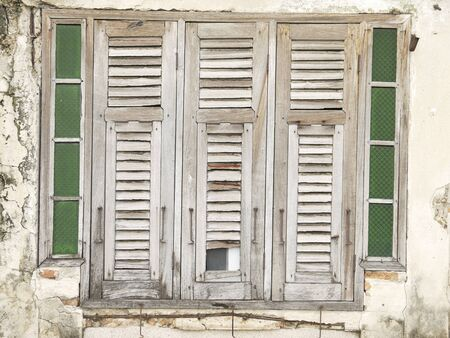 wooden window: old brick wall and old wooden window in thailand