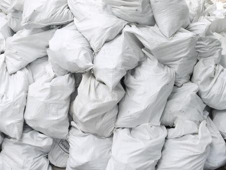 overflows: Pile of white sacks Stock Photo