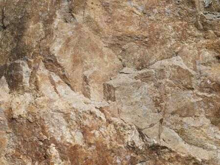 hardwearing: Dark brown stone with cracks on the surface Stock Photo