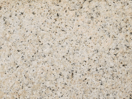 brown granite: Beige and Brown Granite Surface Texture. Focus across entire surface. Stock Photo