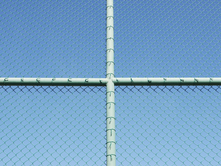 Green seamless fence chain, Iron wire fence on blue sky background