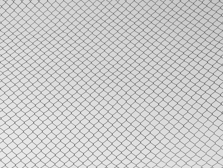 enclose: Steel mesh with a gray sky background Stock Photo