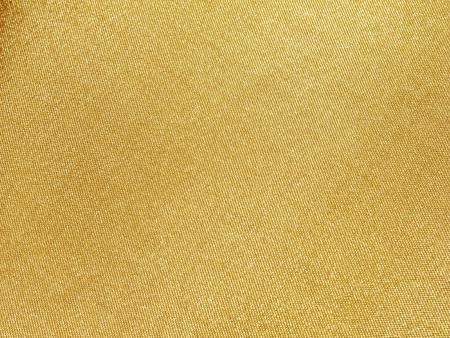 tela algodon: Hilos de oro en la tela Foto de archivo