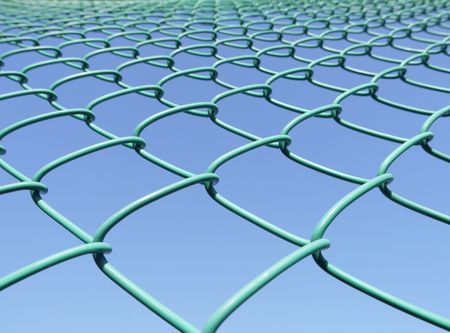 chainlink fence: closeup Green seamless fence chain, Iron wire fence on blue sky background Stock Photo