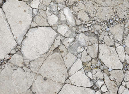 stonemason: A grungy fractured concrete pavement for textural background Stock Photo