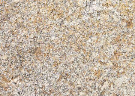 hardwearing: Rough brown stone surface background