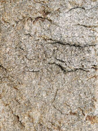 hardwearing: Rough brown stone surface Stock Photo