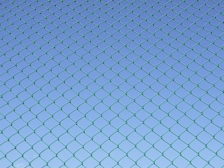 prison system: Green seamless fence chain, Iron wire fence on blue sky background