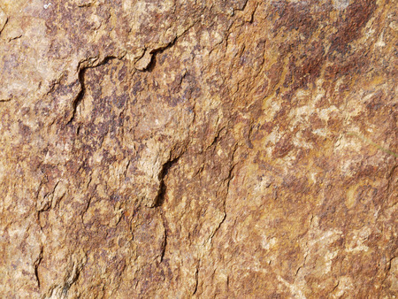steadfast: Dark brown stone with cracks on the surface Stock Photo