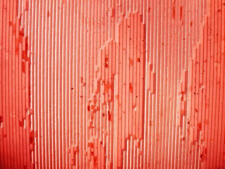 scratchy: Red ribbed scratchy plastic as a background