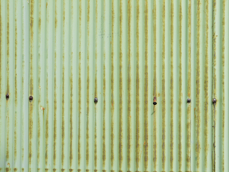 corrugated steel: dirty and Rusted,galvanized iron roof ,large tin background Stock Photo