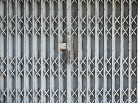 iron curtains: The background image of the old steel shutter