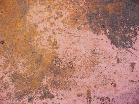 crackles: rust on pink painted iron texture