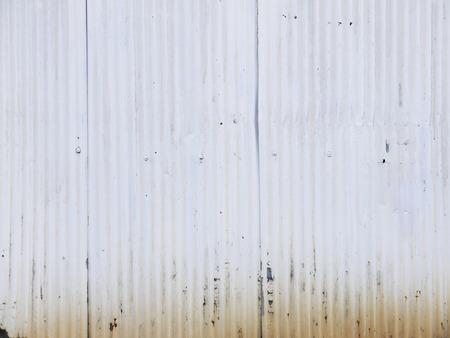foundry: Old damage rusty zinc plat wall