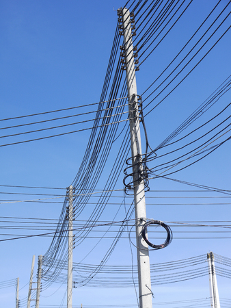 cable tangle: High voltage power pole with wires tangled Stock Photo