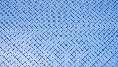 chainlink fence: Green seamless fence chain, Iron wire fence on blue sky background