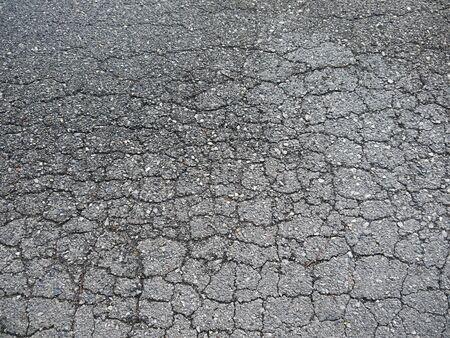 worn: Old worn and cracked asphalt with cracks