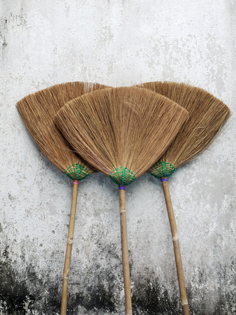 slovenly: Thailands broom on grunge wall Stock Photo