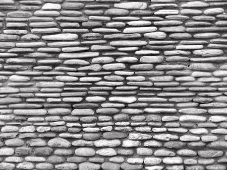 stone mason: Stone wall in black and white close-up