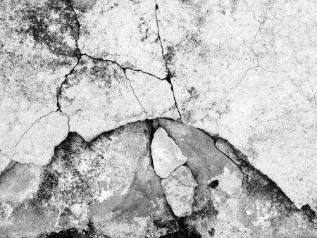 ravel: Cracked concrete texture closeup background