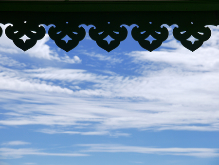 silhouette of Thai roof edge in blue sky