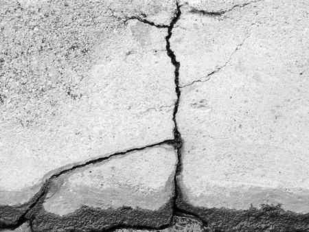 or shatter: Cracked concrete texture closeup background