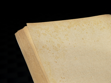 yellowish: old vintage paper book on black background Stock Photo