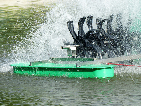 fill: Aerator turbine wheel fill oxygen into water in lake Stock Photo