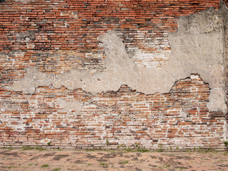 cracked wall: cracked concrete vintage brick wall background Stock Photo