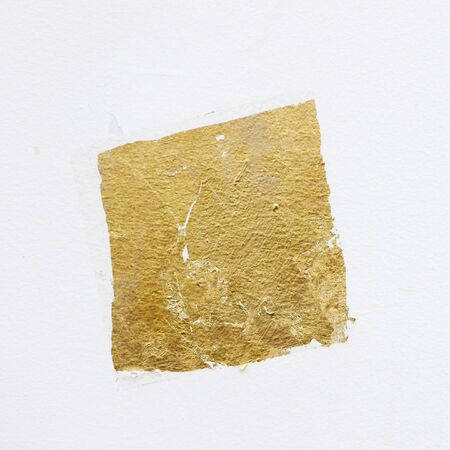 gold leaf on white wall texture background Stock Photo