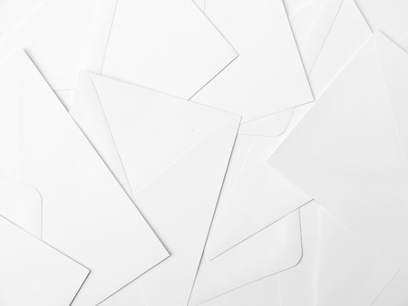 writing implements: Stack of white envelops