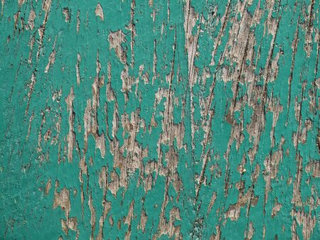 flaking: old green board with cracks