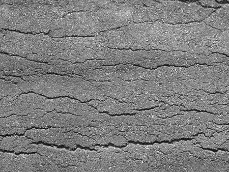 worn structure: Old worn and cracked asphalt with cracks