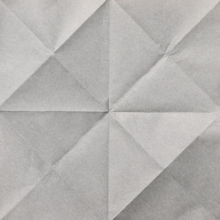 page down: gray sheet of paper folded texture