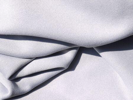 Crumpled white fabric cloth texture