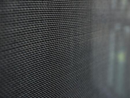 ammonium: Mosquito wire screen texture on the window closeup Stock Photo