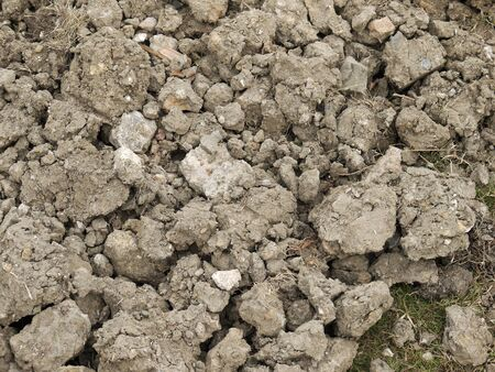 dirt pile: A pile of dirt and rubble at a construction site